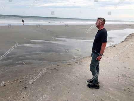 """This image taken from video shows storm surge expert Hal Needham, in North Myrtle Beach, N.C. Florence's storm surge will probably be 7 to 11 feet above ground in parts of North Carolina, according to the National Hurricane Center. Even if a house is elevated 10 feet, with that kind of storm surge, """"there's a good chance there's going to be water inside of it,"""" Needham said"""