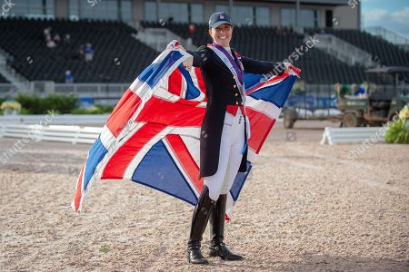 Charlotte DUJARDIN (GBR) poses with a Union Jack after winning the individual bronze medal in the Grand Prix Special with MOUNT ST JOHN FREESTYLE - Dressage - Grand Prix Special - FEI World Equestrian Games- Tryon 2018 - Tryon, North Carolina, USA - 14 September 2018
