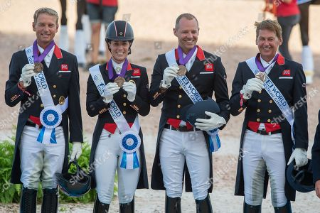 Stock Picture of Dressage team bronze medalists Great Britain (L-R) Carl Hester, Charlotte Dujardin, Spencer Wilton and Emile Faurie  - FEI World Equestrian Games- Tryon 2018 - Tryon, North Carolina, USA - 13 September 2018