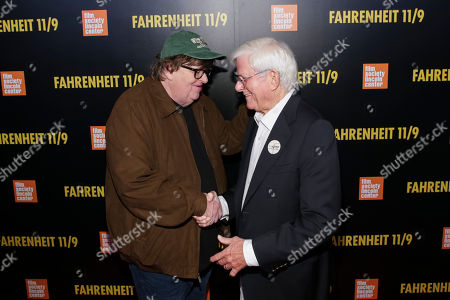 "Michael Moore, Phil Donahue. Filmmaker Michael Moore, left, and television host Phil Donahue attend the premiere of ""Fahrenheit 11/9"" at Alice Tully Hall, in New York"