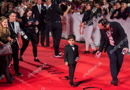 "Actor Parker Sevak, center, walks arrives on the red carpet for the new movie ""The Kindergarten Teacher "" during the 2018 Toronto International Film Festival in Toronto on"