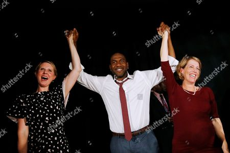 Gubernatorial candidate Cynthia Nixon, fromleft, candidate for Lt. Governor Jumaane Williams and state attorney general candidate Zephyr Teachout greet the crowd together at the Working Families Party primary night party, in New York