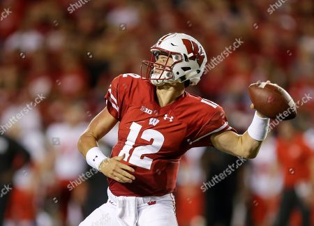 Wisconsin quarterback Alex Hornibrook throws a pass against Western Kentucky during the first half of an NCAA college football game, in Madison, Wis. Tight end Zander Neuville returned last week from injury and receiver Danny Davis is due back from suspension. Two more targets for Hornibrook