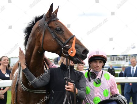 Thomas Hobson and jockey, Ryan Moore after winning The Doncaster Cup Stakes.