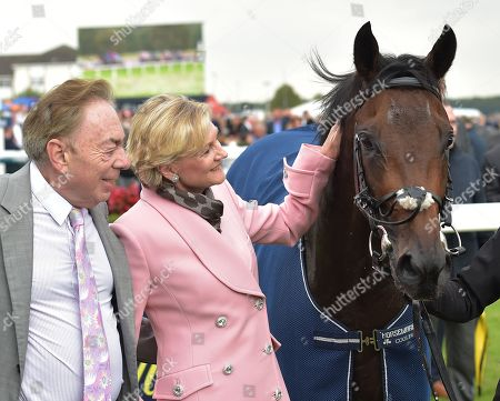 Sir Andrew Lloyd Webber and Lady Lloyd-Webber with Too Darn Hot, after it had won The Howcroft Industrial Supplies Champagne Stakes.