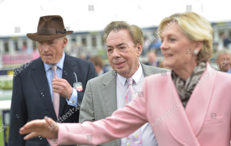 John Gosden, trainer, with Lord and Lady Lloyd-Webber after Too Darn Hot had won The Howcroft Industrial Supplies Champagne Stakes.