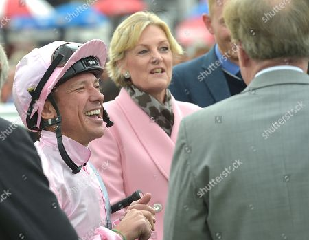 Frankie Dettori with Lord and Lady Lloyd-Webber before Too Darn Hot had won The Howcroft Industrial Supplies Champagne Stakes.