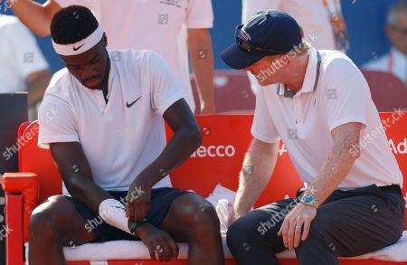 Jim Courier, right, manager of the United States team speaks to Frances Tiafoe of the United States during a game break in his Davis Cup semifinal singles tennis match against Marin Cilic of Croatia in Zadar, Croatia, . Croatia and the United States are playing in the semifinals of the World Group Davis Cup tennis