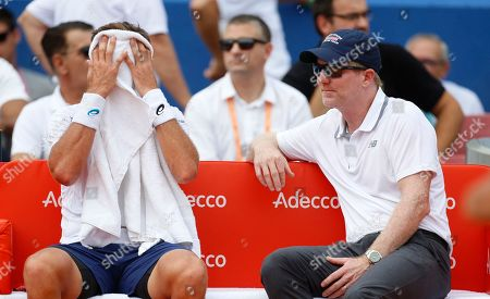 Jim Courier, right, manager of the United States team speaks to Steve Johnson of the United States during a game break in his Davis Cup semifinal singles tennis match against Borna Coric of Croatia in Zadar, Croatia, . Croatia and the United States are playing in the semifinals of the World Group Davis Cup tennis