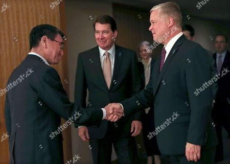 Japan's Foreign Minister Taro Kono (L) shakes hands with US special representative for North Korea Stephen Biegun (R) as US ambassador to Japan William Hagerty (C) looks on during their meeting in Tokyo, Japan, 14 September 2018.