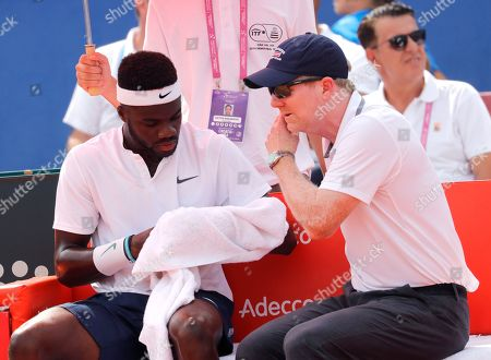 Frances Tiafoe (L) of USA reacts next to Head Coach Jim Courier (R) of USA during his match against Marin Cilic of Croatia for the Davis Cup semi final tie between Croatia and the USA in Zadar, Croatia, 14 September 2018.