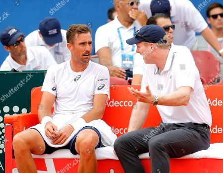 Steve Johnson (L) of the USA and his team captain Jim Courier during the Davis Cup semi final tie between Croatia and the USA in Zadar, Croatia, 14 September 2018.