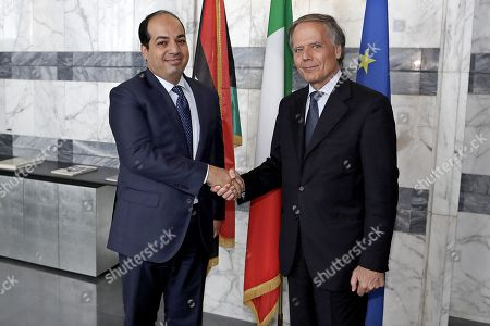 Italian Minister for Foreign Affairs Enzo Moavero Milanesi (L) shakes hands with Deputy Prime Minister of Libya Ahmed Maiteeq during their meeting in Rome, Italy, 14 September 2018.