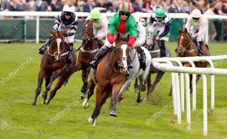winner THOMAS HOBSON (Ryan Moore) in last place as JUKEBOX JIVE (Joe Fanning) leads in the early stages of The Doncaster Cup Stakes Doncaster