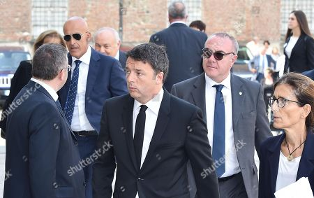 Former Italian premier Matteo Renzi (C) arrives at a mass held in memory of Italian - Canadian businessman CEO of Fiat Chrysler Automobiles Sergio Marchionne in Turin, Italy, 14 September 2018. Marchionne died in Zurich on 25 July 2018.