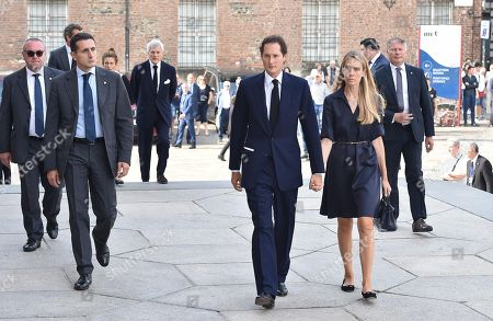 President of FCA Italy, John Elkann (C) and his wife Lavinia arrive at a mass held in memory of Italian - Canadian businessman CEO of Fiat Chrysler Automobiles Sergio Marchionne in Turin, Italy, 14 September 2018. Marchionne died in Zurich on 25 July 2018.