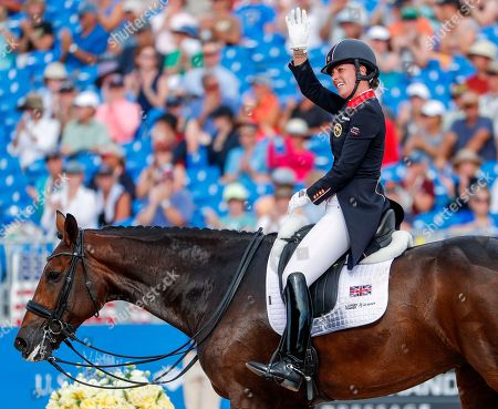Stock Image of Charlotte Dujardin of Britain reacts after competing aboard Mount St John Freestyle during the individual Dressage Grand Prix Special at the FEI World Equestrian Games 2018 at the Tryon International Equestrian Center in Mill Spring, North Carolina, USA, 14 September 2018. Dujardin won the bronze medal in the event. The World Equestrian Games continue through 23 September 2018.
