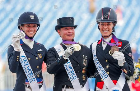 Stock Photo of Gold medalist Isabell Werth (C) of Germany stands with silver medalist Laura Graves (L) of the US and bronze medalist Charlotte Dujardin (R) after the individual Dressage Grand Prix Special at the FEI World Equestrian Games 2018 at the Tryon International Equestrian Center in Mill Spring, North Carolina, USA, 14 September 2018. The World Equestrian Games continue through 23 September 2018.