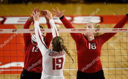 , 2018Washington State Cougars Ashley Brown (19) spikes the ball between Northern Illinois Huskies Jasmine Kemp (12) and Northern Illinois Huskies Meg Wolowicz (18) in a match between the Northern Illinois Huskies and the Washington State Cougars at E.A. Diddle Arena in Bowling Green, KY. Photographer: Steve Roberts