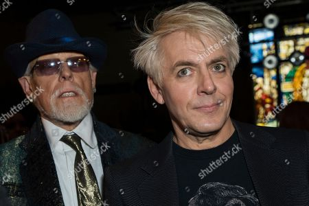 Stock Image of Antony Price, Nick Rhodes. Designer Antony Price, left and Duran Duran band member Nick Rhodes pose for photographers prior to the Pam Hogg Spring/Summer 2019 runway show at London Fashion Week in London