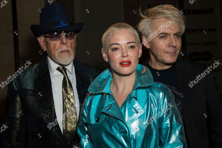 Stock Image of Antony Price, Rose McGowan, Nick Rhodes. From left, Designer Antony Price, actress Rose McGowan and Duran Duran band member Nick Rhodes pose for photographers prior to the Pam Hogg Spring/Summer 2019 runway show at London Fashion Week in London
