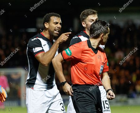Anton Ferdinand of St. Mirren makes his feelings known to Referee Andrew Dallas following Olivier Ntcham of Celtic's challenge on Stephen McGinn of St. Mirren. Referee Andrew Dallas sent Olivier Ntcham off for a second yellow card offence.