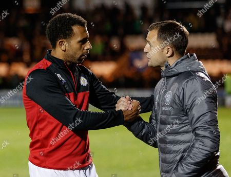 Anton Ferdinand of St. Mirren chats with Celtic Assistant Manager Chris Davies after the final whistle.