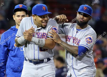 Jose Reyes, Dominic Smith. New York Mets' Jose Reyes, right, and Dominic Smith (22) joke around as they celebrate their victory over the Boston Red Sox in a baseball game at Fenway Park, in Boston