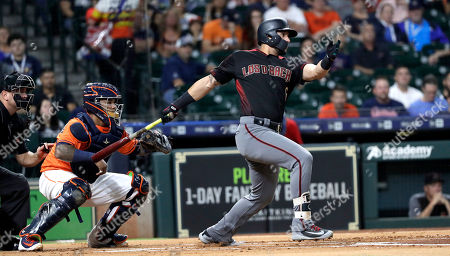 Stock Picture of Arizona Diamondbacks' David Peralta, right, hits a two-run single as Houston Astros catcher Martin Maldonado reaches for the pitch during the first inning of a baseball game, in Houston