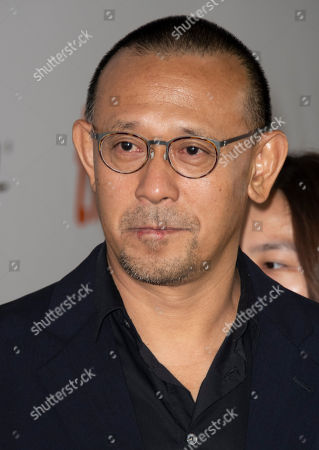 Chinese director Jiang Wen arrives for the screening of the movie 'Hidden Man' during the 43rd annual Toronto International Film Festival (TIFF) in Toronto, Canada, 14 September 2018.