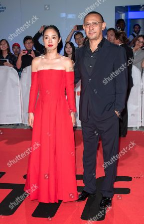 Stock Image of Chinese actress and cast member Zhou Yun (L) and her husband Chinese director Jiang Wen (R) arrive for the screening of the movie 'Hidden Man' during the 43rd annual Toronto International Film Festival (TIFF) in Toronto, Canada, 14 September 2018.