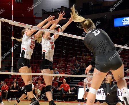 Washington State Cougars McKenna Woodford (5) shot gets blocked by Western Kentucky Hilltoppers Sophia Cerino (23) and Western Kentucky Hilltoppers Rachel Anderson (4) in a match between the #22 Washington State Cougars and the Western Kentucky Hilltoppers at E.A. Diddle Arena in Bowling Green, KY. WSU takes down WKU 3-1 Photographer: Steve Roberts