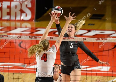 Western Kentucky Hilltoppers Rachel Anderson (4) and Washington State Cougars McKenna Woodford (5) try and tip the ball in a match between the #22 Washington State Cougars and the Western Kentucky Hilltoppers at E.A. Diddle Arena in Bowling Green, KY. WSU takes down WKU 3-1 Photographer: Steve Roberts