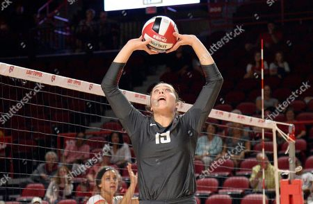 Washington State Cougars Ashley Brown (19) sets the ball in a match between the #22 Washington State Cougars and the Western Kentucky Hilltoppers at E.A. Diddle Arena in Bowling Green, KY. WSU takes down WKU 3-1 Photographer: Steve Roberts