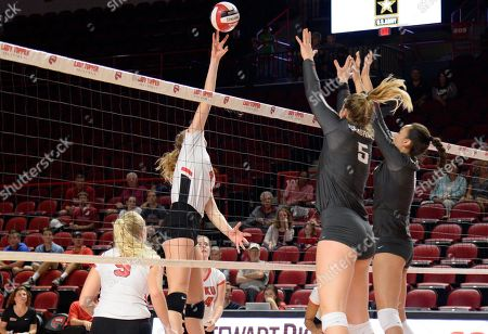 Western Kentucky Hilltoppers Rachel Anderson (4) tips the ball over Washington State Cougars McKenna Woodford (5) and Washington State Cougars Hannah Pukis (9) in a match between the #22 Washington State Cougars and the Western Kentucky Hilltoppers at E.A. Diddle Arena in Bowling Green, KY. WSU takes down WKU 3-1 Photographer: Steve Roberts
