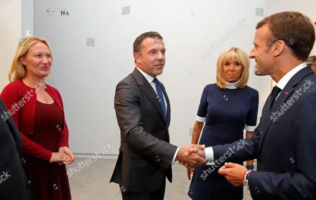"France's President Emmanuel Macron and his wife Brigitte, second from right, meet Olivier Widmaier Picasso, center, and Diana Widmaier Picasso, grandson and granddaughter of Pablo Picasso, during his visit of the ""Picasso. Bleu et rose"" (Picasso. Blue and Rose) exhibition dedicated to Pablo Picasso's blue and rose periods at the Musee d'Orsay in Paris, France"