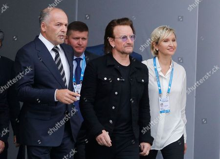"Stock Picture of Irish lead singer of rock band U2, Paul David Hewson aka Bono, center, Ukrainian tycoon and philanthropist Viktor Pinchuk, left, and business woman Elena Pinchuk, walk, during the 15th Yalta European Strategy (YES) annual meeting entitled ""The next generation of everything"" at the Mystetsky Arsenal Art Center in Kiev, Ukraine"