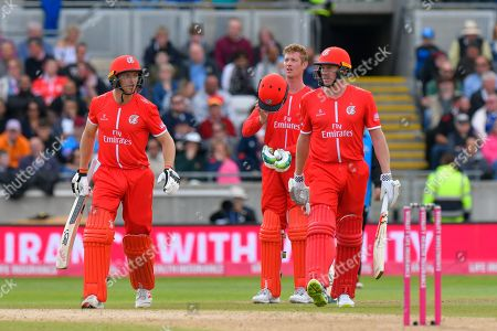 James Faulkner of Lancashire comes out to bat along with Jos Buttler of Lancashire as his runner during the Vitality T20 Finals Day Semi Final 2018 match between Worcestershire Rapids and Lancashire Lightning at Edgbaston, Birmingham