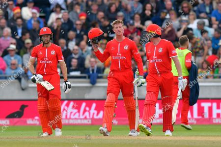 James Faulkner of Lancashire comes out to bat along with Jos Buttler of Lancashire who is his runner during the Vitality T20 Finals Day Semi Final 2018 match between Worcestershire Rapids and Lancashire Lightning at Edgbaston, Birmingham