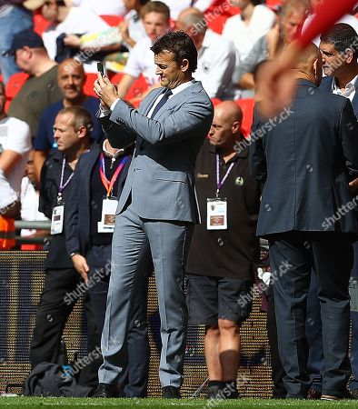 Former Australia cricketer Adam Gilchrist looks on from pitchside