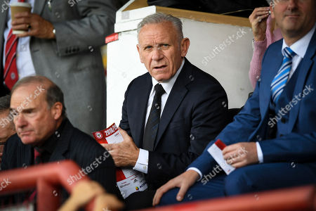 Peter Reid of Wigan sitting in the stands