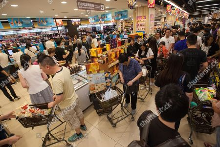 A long line forms as people panic buy food supplies in preparation for the arrival of Super Typhoon Mangkhut, in a supermarket in Hang Hau, Tseung Kwan O, New Territories, Hong Kong, China, 15 September 2018. Experts say Super Typhoon Mangkhut will be the most powerful tropical storms to hit Hong Kong in decades.