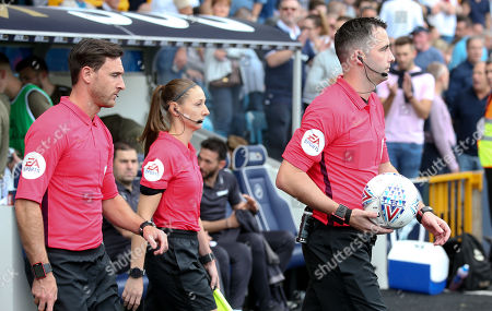 Stock Picture of Referee Chris Kavanagh and assistants Dan Cook & Sian Massey-Eliis with Mitre Delta Match ball / balls - EFL Sleeve patches branding