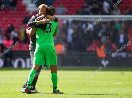 Liverpool Manager Jurgen Klopp celebrates Alison Becker following the 2-0 win over Tottenham Hotspurs