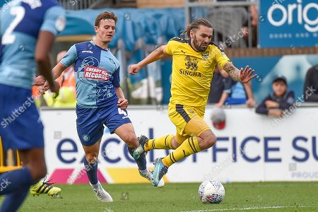 Oxford United midfielder (on loan from Sheffield United) Ricky Holmes) (12) is fouled by Wycombe Wanderers midfielder Dominic Gape (4) during the EFL Sky Bet League 1 match between Wycombe Wanderers and Oxford United at Adams Park, High Wycombe