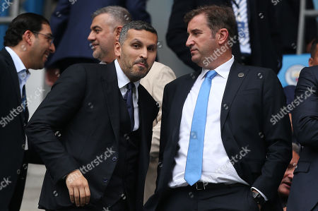 Manchester City chairman Khaldoon Al Mubarak (left) watches on with a smile alongside chief executive Ferran Soriano