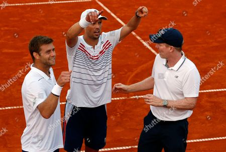 Mike Bryan, center, Ryan Harrison, left and team captain Jim Courier of the US celebrate after defeating Croatia's Ivan Dodig and Mate Pavic in their Davis Cup semifinal doubles match, in Zadar, Croatia