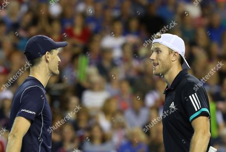Jamie Murray   with Dominic Inglot  celebrate as they beat Sanjar Fayziev and Denis Istomin  in the Doubles