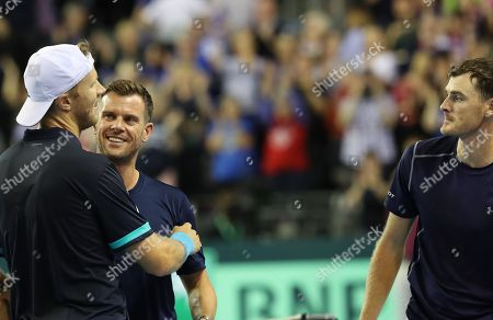 Jamie Murray   with Dominic Inglot  celebrate as they beat Sanjar Fayziev and Denis Istomin  in the Doubles watched by  Captain Leon Smith