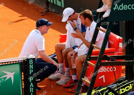 Mike Bryan (C) and Ryan Harrison (R)  and their Head Coach Jim Courier (L) of USA react in the double match for the Davis Cup semi final tie between Croatia and the USA in Zadar, Croatia, 15 September 2018.